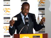 Wyclef in suit at Yele Haiti press conference